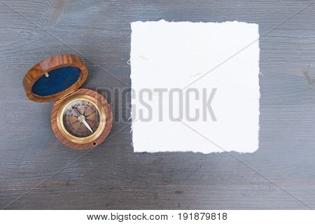 Old vintage compass, copy space on white paper