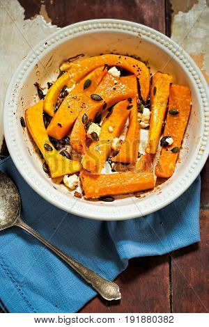 Roasted butternut squash with feta and pumpkin seeds