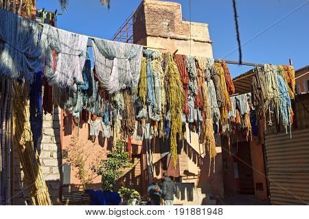 Bundles of coloured, dyed wool drying in the souks of Marrakech