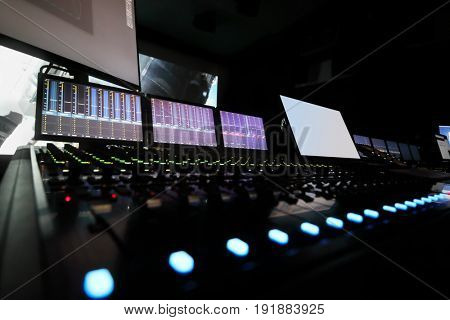 Dark recording studio with modern equipment on movie studio, cinema display out of focus