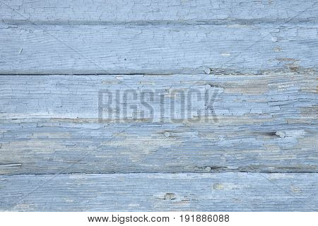 Old wooden boards with cracking peeling paint