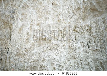 Texture background abstract of surface cretaceous limestone hill. The deposits of chalk. In madura Island Indonesia