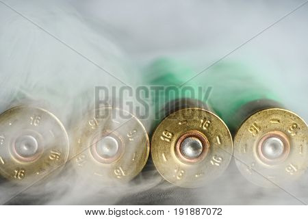 Used, Empty Cartridges For Shotguns In The Entire Frame In Smoke