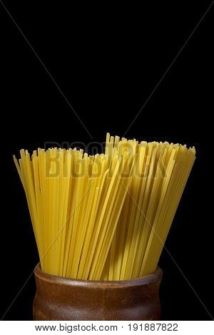 Bundle of spaghetti in Italian brown pottery