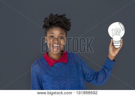 African Descent Woman Holding Light Bulb