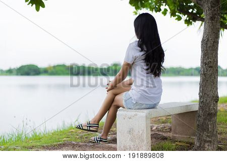 Asian Woman Lonely In The Park