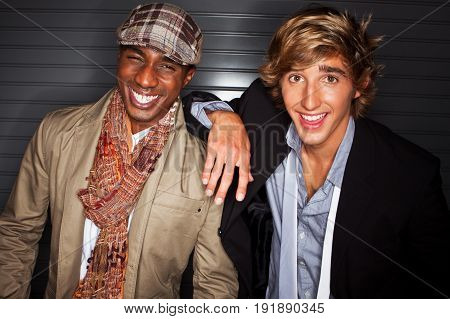 Fashionable young men laughing and hanging out.