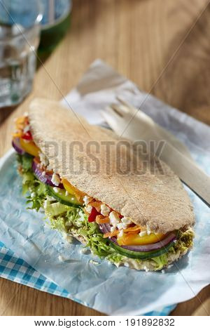 Healthy pita bread with feta and vegetables
