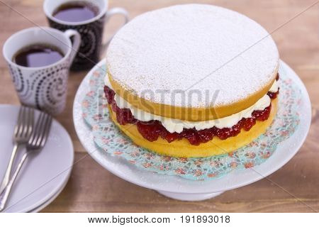 Victoria Sponge Cake with jam and whipped cream