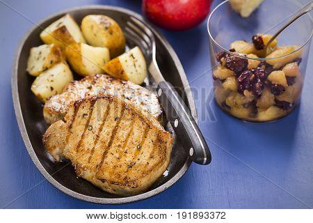 Pork chops with apple raisins and ginger chutney