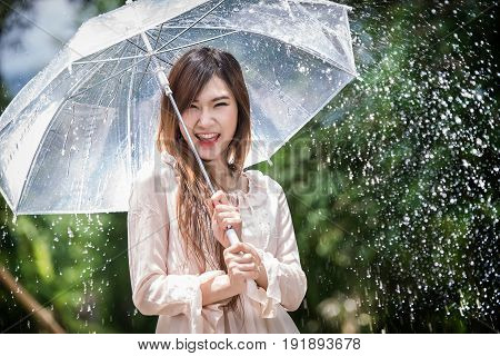 Happy Chinese Girl Is Getting Wet And Rain