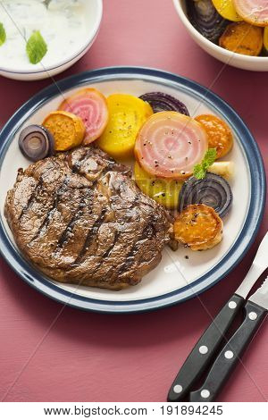 Grilled steak with colourful beetroot salad and mint dressing