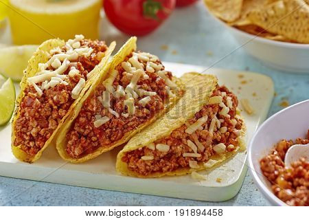 Turkey chilli tacos with melting cheddar cheese