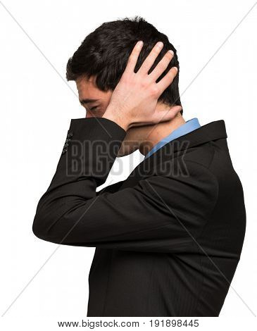 Side portrait of a desperate business man. Isolated on white