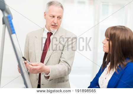 Businessman teaching business concepts to a new employee