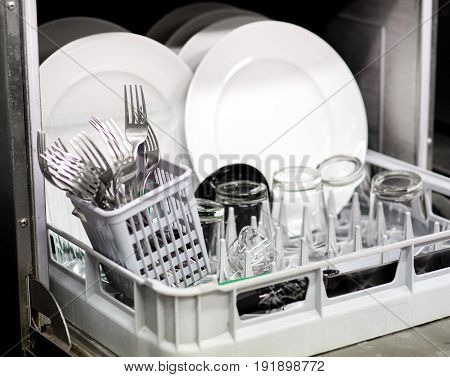 Clean Dishes, Glasses And Cutlery In A Dishwasher