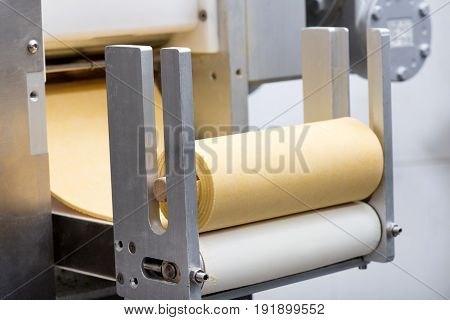 Roll Of Uncooked Pasta Dough On A Machine