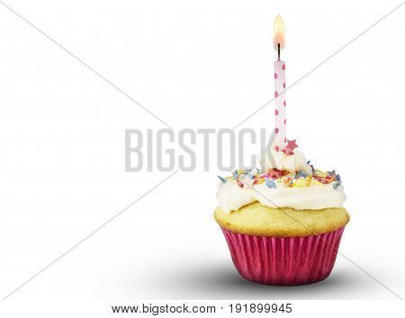 Single cup cake with lit pink spotted candle isolated on white background