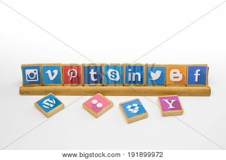 QUEENSTOWN SOUTH AFRICA - 09 APRIL 2017: Social Media logotype popular collection printed and place on wood scrabble game pieces isolated beech wood stand and white background - editorial illustrative image