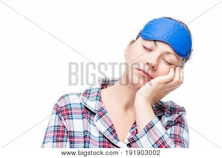 Woman In Pajamas Fell Asleep In A Sitting Position, Portrait On A White Background