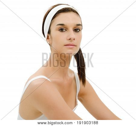 a beautiful young woman with white headband in hair