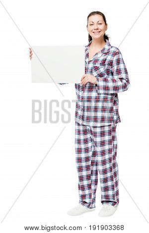 Portrait Of A Woman In Pajamas In Full Length With An Empty Poster On A White Background