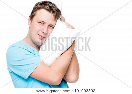 Horizontal Portrait Of 30 Year Old Man With Pillow On White Background