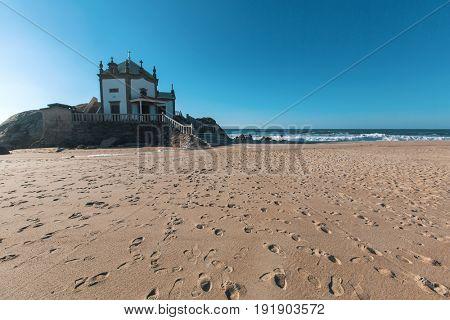 Chapel Senhor da Pedra on Miramar Beach (Praia de Miramar), Vila Nova de Gaia, Portugal.