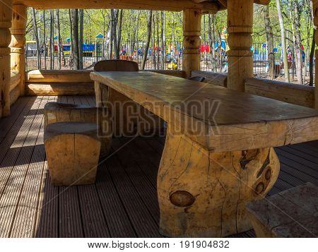 Arbor in a park of logs. Relax in the summer.
