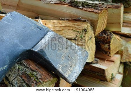 Axe and firewood logs close up. Horizontal image