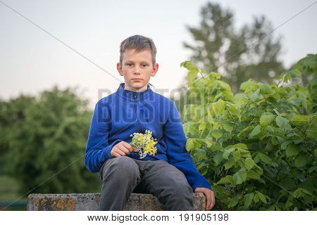 Portrait Of A Teenage Boy In The Evening