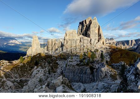 Cinque Torri rock formation under evening sun Dolomite Alps Italy