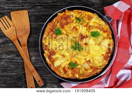 Spanish Tortilla In Skillet On Table