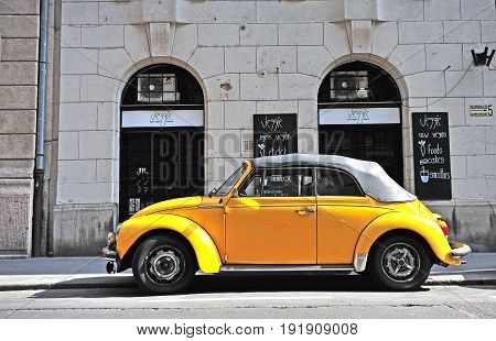 BUDAPEST HUNGARY - MAY 29: Yellow retro Volkswagen beetle car in in street of Budapest on May 29 2016.