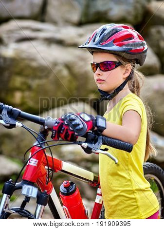 Woman on bicycle ride mountain. Girl traveling in summer park. Rock in background. Cycling person with rucksack. Sport trip is good for health. Healthy active lifestyle. Child lost his way.