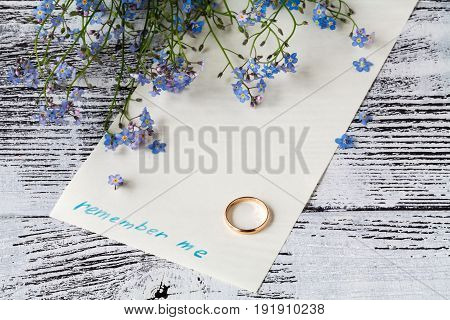 Branch Of Forget-me-nots On Paper With Phrase Remember Me