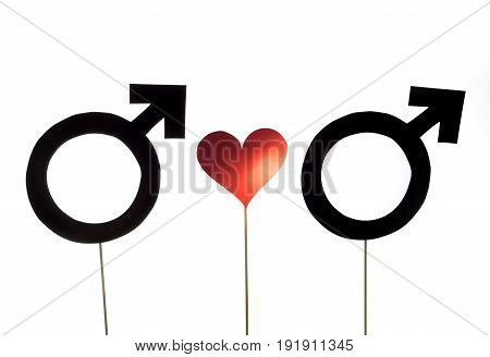 Homosexuality concept. Homosexual gay couple in love. Male gender and heart symbols and signs cut from cardboard and wooden stick. Tolerance and LGBT theme and sexual minority rights.