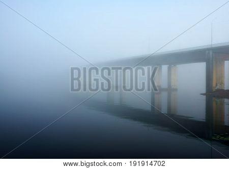 Summer river and bridge, misty morning landscape