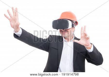 Foreman Wearing Yellow Hardhat And Vr Goggles And Gesturing