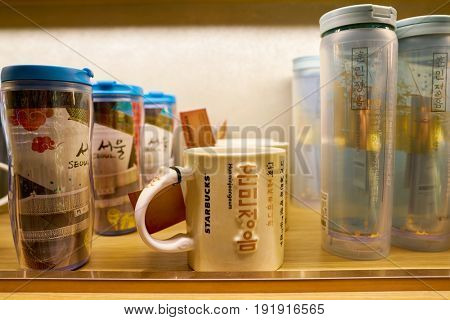 SEOUL, SOUTH KOREA - CIRCA MAY, 2017: close up shot of goods on display at Starbucks in Seoul. Starbucks Corporation is an American coffee company and coffeehouse chain.