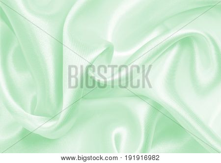 Smooth Elegant Green Silk Or Satin Cloth Texture As Abstract Background. Luxurious Background Design