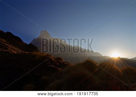Sunrise in the Himalaya mountains. Machapuchare peak, Fish tail top. Sunbeams. Nepal, Annapurna region, Mardi Himal track.