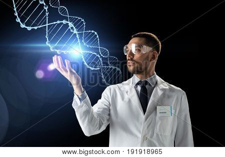 science, genetics and people concept - male doctor or scientist in white coat and safety glasses with dna molecule projection over black background