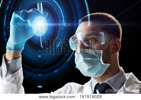 science, research and people concept - young scientist in safety glasses and face mask with test tube and virtual projection