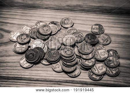 Old Soviet Coins On A Wooden Background - Monochrome Vintage Look