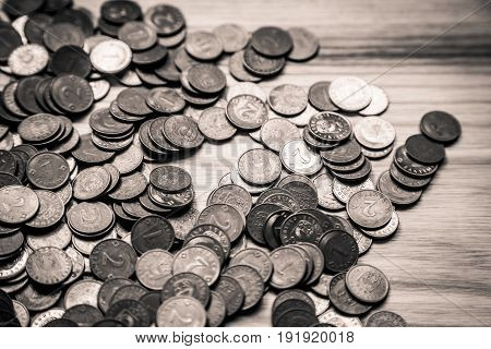 Old Latvian Coins On A Wooden Background - Monochrome Vintage Look