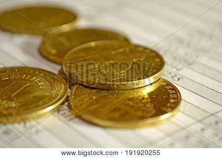 Financial background with ctack of coins and table.
