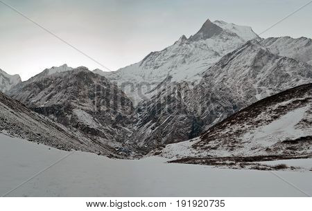 Sunrise in the Snowy Himalayan mountains. Machapuchare peak, Fish tail top. Nepal, Annapurna region, Annapurna Base Camp Track.
