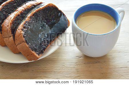 bread slice dressing creamy chocolate sauce and coffee