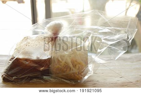 noodle and soup packing in plastic bag for take home